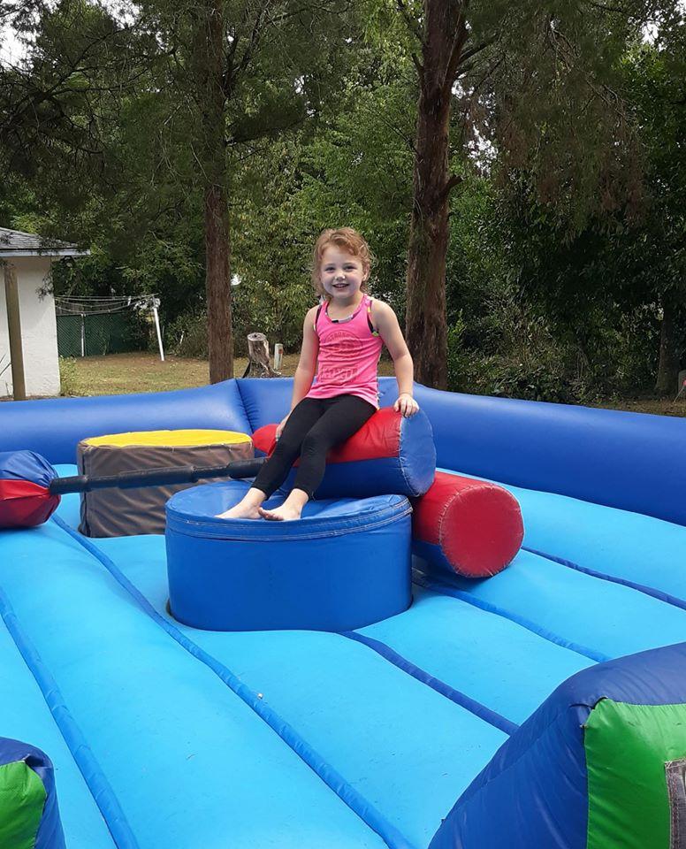 Girl on inflatable gladiator jousting Ocala, FL
