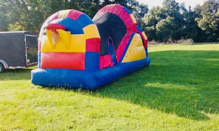 three in one combo; bounce house, water slide, basket hoop